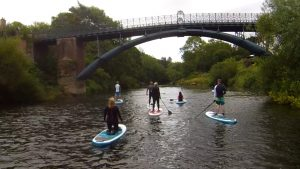 Stand up paddle boarding on the river